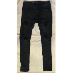 Jeans bleu fonceé déchiré